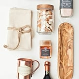 Check out all the other delightful pieces you can look for at your local HomeGoods. (How great is that wooden tray?)     Natural wooden appetizer tray ($17)  Aged balsamic vinegar ($13)  Kalamata olive jar ($9)   Source: Style Me Pretty