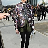 At Paris Fashion Week, Olivia topped dressed-up shorts with a floral bomber.