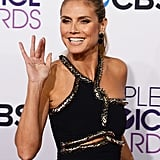 Heidi Klum flashed her playful smile on the red carpet.