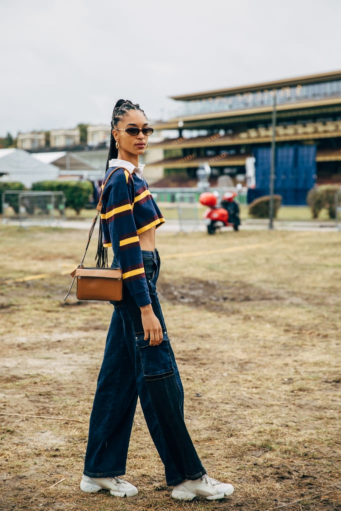 Embrace your inner '90s vibe with a cropped top and baggy jeans.