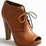 We love the cool, dark camel hue paired with the lace-up detail. Shirley bootie ($70)