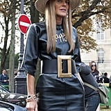 Anna Dello Russo put on a happy face necklace and a bold belt.