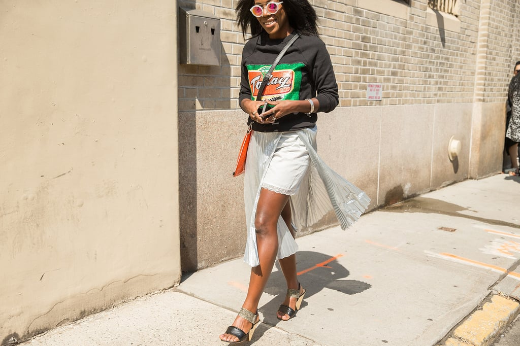 A Skirt Layered Over Lace Shorts Met With a Sweatshirt and Mules