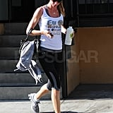 Gisele Bundchen carries a water bottle and jacket leaving the gym.
