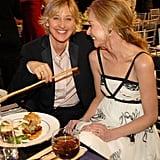 Portia de Rossi and Ellen DeGeneres had a laugh during dinner at the January 2006 SAG Awards.