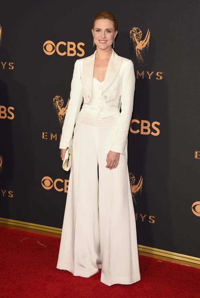 Are you keeping up with Evan Rachel Wood's love for pantsuits? We sure are. Evan, who is nominated in the lead actress in a drama category for Westworld, walked the 2017 Emmys red carpet in a Jeremy Scott For Moschino white suit. The three-piece ensemble was composed of a structured cropped vest, corset-like top, and flared trousers. It was an elegant and formal look, setting her apart from the sea of dresses. The star has been vocal about the empowering reasons she wears pantsuits on the red carpet and it appears she is 100 percent dedicated to this cause, now and forever.