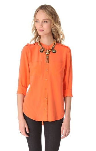 We envision this Equipment orange blouse ($218) really coming to life with maroon leather pants and an army-green jacket. You can also pair it with black trousers and a blazer for work.