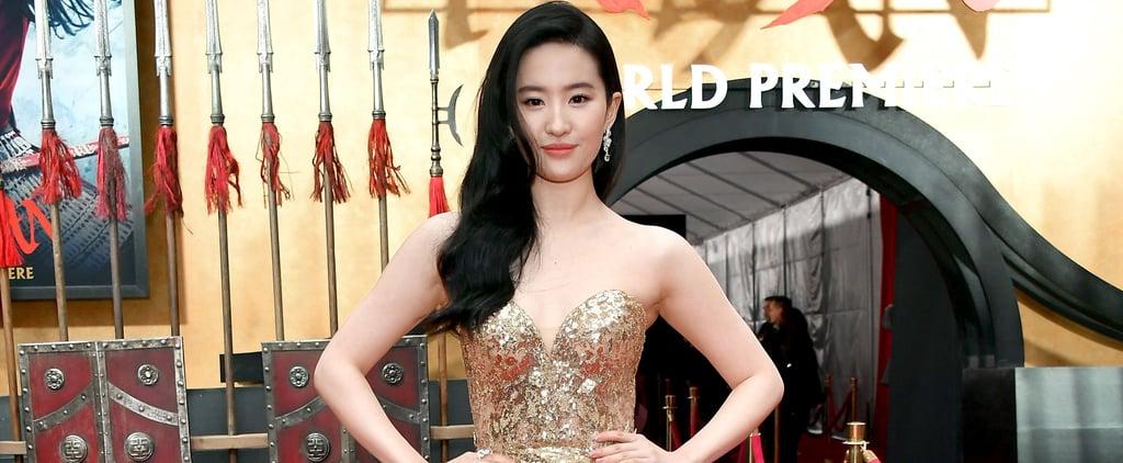 Yifei Liu Wearing Gold Elie Saab Gown at Mulan Premiere