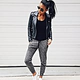 A Leather Jacket, Solid Shirt, Joggers, and Sneakers