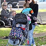 Isla Fisher carried her baby girl, Elula Cohen, while out for a walk.