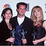 Courteney Cox, Lisa Kudrow and Matthew Perry stayed close while posing with their SAG Awards in 1996.
