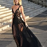 Rosie channelled a dark angel while arriving at the Versace show during Paris Fashion Week Couture in July 2015.
