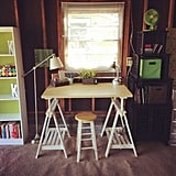 Complete with bookshelves and a small desk, this garage was converted into a homework nook for the homeowner's kids. Aww!