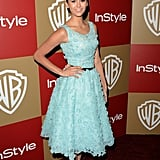 At the InStyle party, Nina Dobrev showed off her flirty sense of style via a full-skirted ladylike look, punched up by a powder-blue hue and an ultraembellished texture. Her high bun, glowing makeup, and strappy heels rounded out her look.