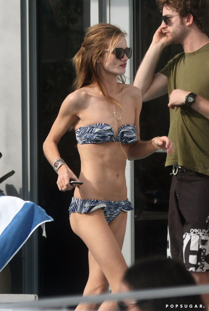 Rosie Huntington-Whiteley hit the hotel pool in Miami during a trip with boyfriend Jason Statham back in January 2012.