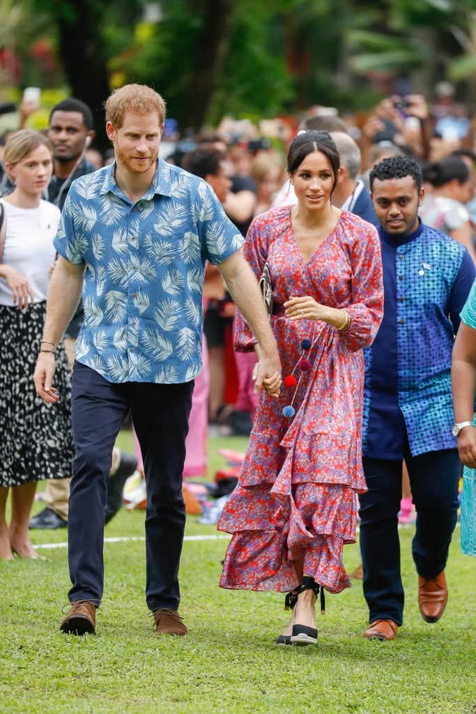 Meghan Markle is making an unforgettable statement with her maternity style. The Duchess of Sussex stepped out in Fiji with husband Prince Harry on Oct. 24 to visit the University of the South Pacific as part of their 16-day royal tour. While Meghan kept things formal the day before, she opted for a more casual Figue printed dress ($1,495) from Shopbop during her Wednesday walk-through. The bold and beautiful outfit, with its multicolored pom-poms and asymmetrical ruffles, perfectly complemented the garlands gifted to the duchess throughout the trip. She paired the ensemble with Karen Walker earrings, a Shaun Leane bracelet, and black Castañer espadrilles — the same pair Pippa Middleton owns! Meghan tied the whole look together with a patterned clutch (that's actually a folder!) made by local women at the Suva Market in Fiji. Check out more snaps of Meghan's outfit ahead, and make sure to keep up with all her outfits from the tour so far.       Related:                                                                                                           Exactly Where You Can Buy All of Meghan Markle's Royal Tour Looks