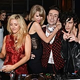 Taylor continued to hug Nick as Ellie took over DJ duties and Karlie watched the whole scene from across the room.