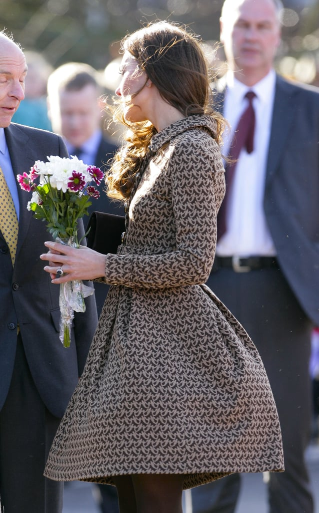 In February 2012, Kate's Orla Kiely dress was blown up by a gust as she visited the Rose Hill Primary School in England.