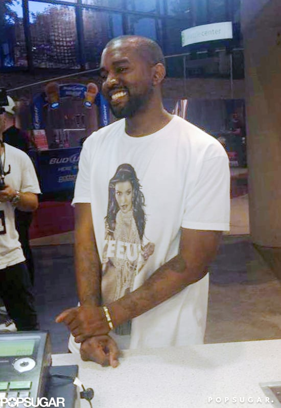 "Forget about wearing your heart on your sleeve, Kanye West wears Kim Kardashian on his shirt. Before kicking off his Yeezus tour in Seattle on Oct. 19, the rapper mingled with fans while wearing a t-shirt that featured a photo of Kim from her 2007 nude photo shoot for Playboy with the words ""Yeezus"" written over the NSFW parts."