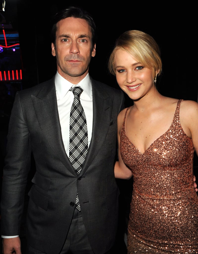Jon Hamm and Jennifer Lawrence were snapped together backstage at the 2011 show.