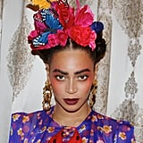 Of course, no Frida Kahlo costume roundup would be complete without an appearance from Beyoncé, who masterfully brought the Mexican artist's look to life last Halloween with a colorful frock, statement earrings, and braided 'do with flowers. If you'd prefer to skip penciling in Frida's signature unibrow, go for brushed up, exaggerated dark brows like Bey's.