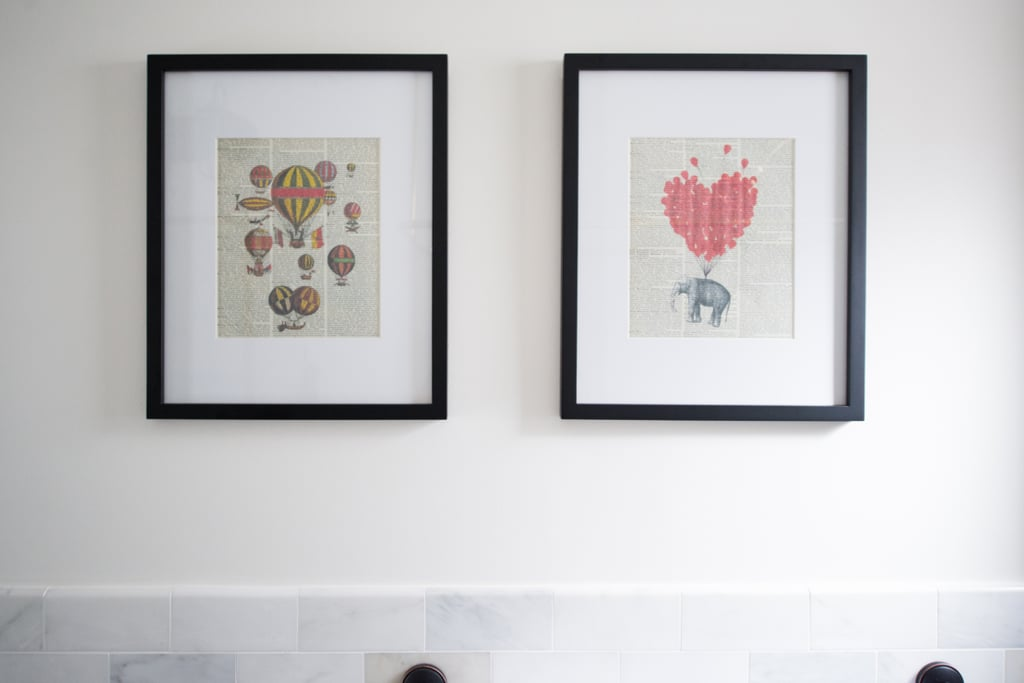 Two whimsical art prints hang above the tiled portion of the wall.  Photo by Samantha Goh via Homepolish