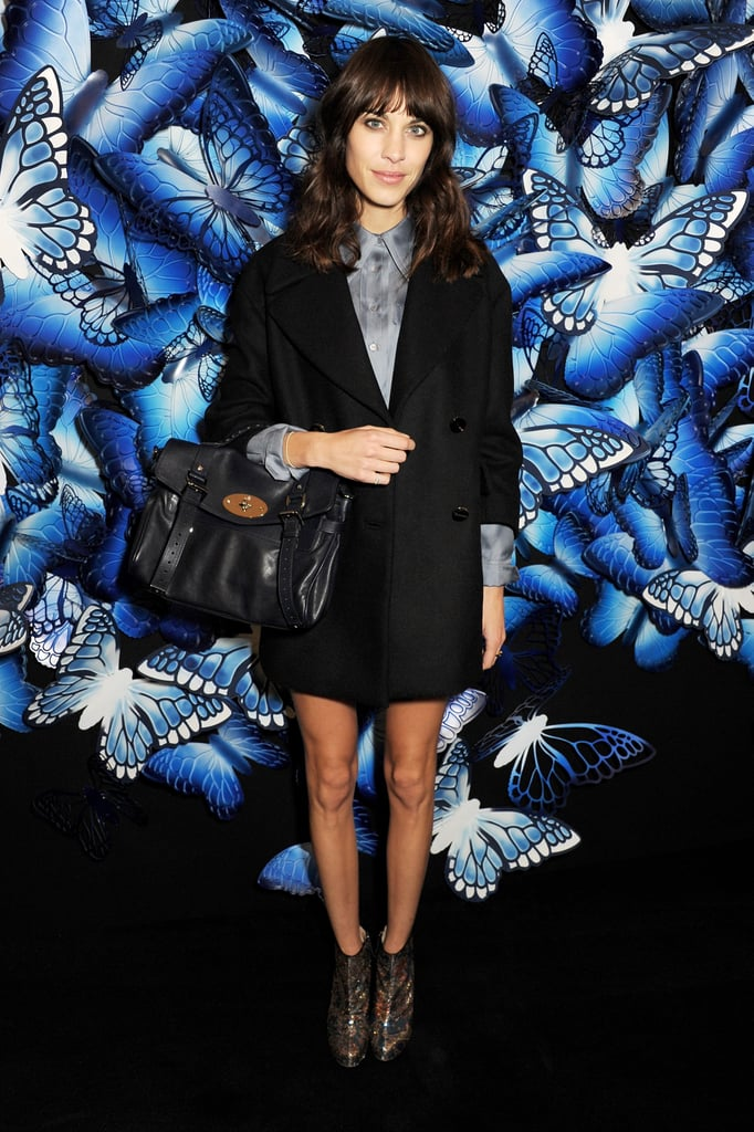 At Mulberry, Alexa Chung showed off her affinity for menswear-inspired styles in a shorts suit, metallic booties, and a midnight-blue Mulberry bag from the A/W 2013 collection.