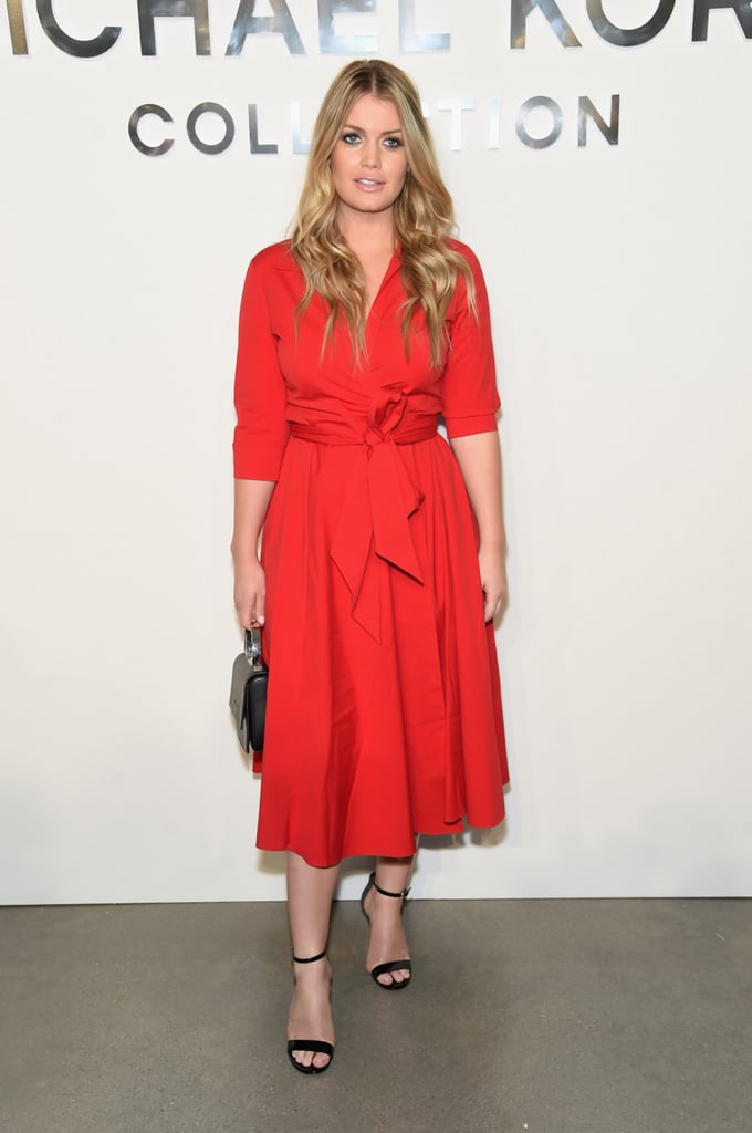 She Opted For A Red Dress And Simple Black Heels When She Attended