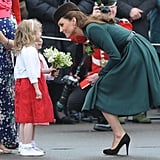 Kate bent down to chat eye to eye with a young fan in Aldershot, England, on St. Patrick's Day in 2012.