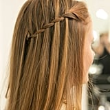 Drop your layers over the pinned-back braid, and admire your pinnable hair.