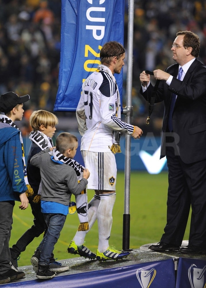 The Beckham boys watched their father take home a medal for the 2011 Major League Soccer Cup.