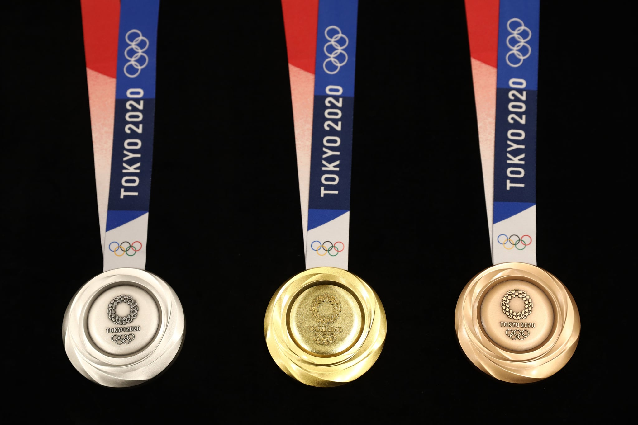 Medals for the Tokyo 2020 Olympic Games are unveiled during a ceremony marking one year before the start of the games in Tokyo on July 24, 2019. - Tokyo entered the final leg of its marathon Olympic preparations, marking a year until the 2020 Games open with officials promising a high-tech but eco-friendly event. (Photo by Behrouz MEHRI / AFP)        (Photo credit should read BEHROUZ MEHRI/AFP/Getty Images)