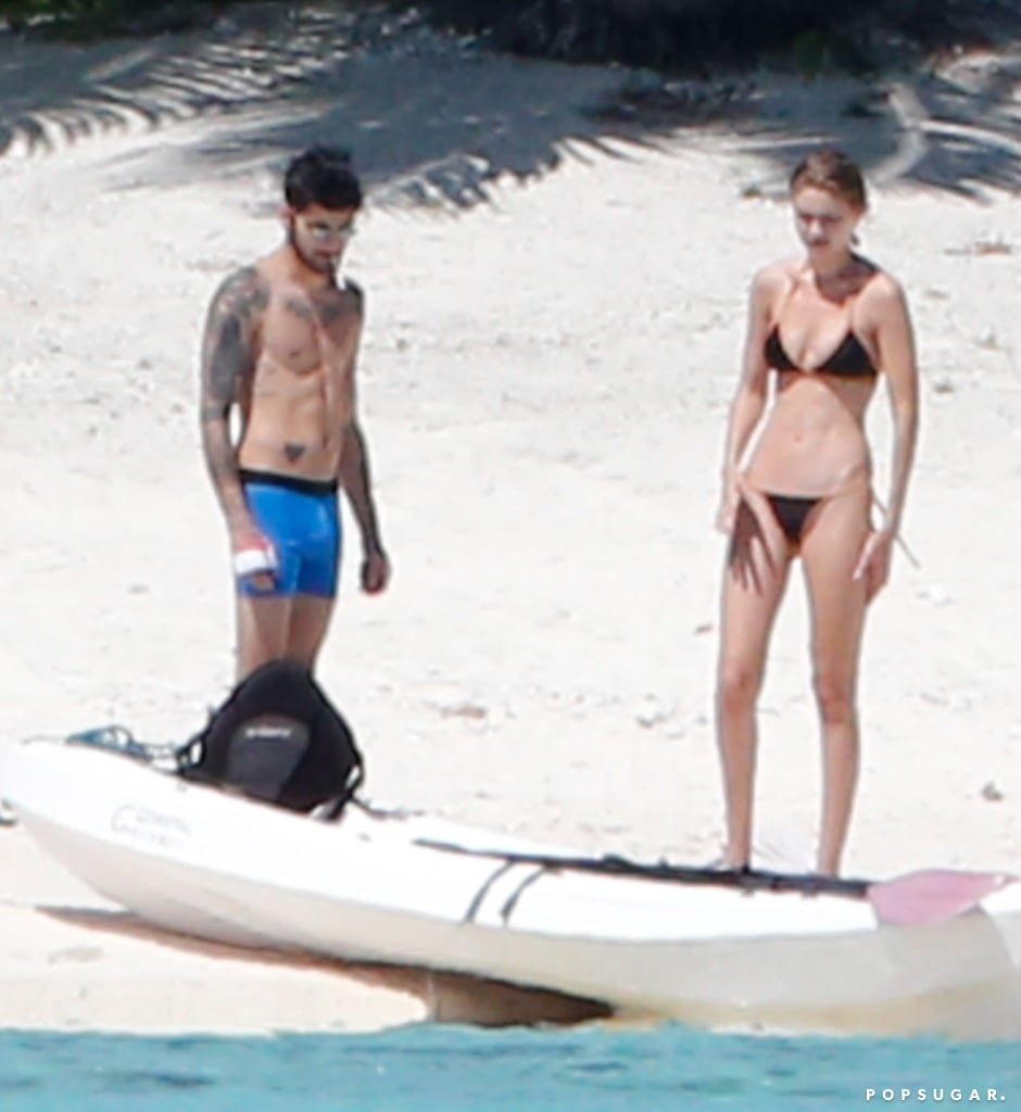 """Gigi Hadid and Zayn Malik are still going strong! The couple, who's been dating on and off since November, recently escaped to the beautiful island of Tahiti, and on Thursday, they hit the beach for some fun in the sun. Gigi showed off her toned figure in a black Vix Swimwear bikini while enjoying a kayak ride with Zayn, who initially only wore boxer briefs before throwing on a pair of orange board shorts. The pair took turns paddling in the ocean, and after getting their daily dose of vitamin D, they left the beach walking hand in hand. Both stars have been super busy as of late, with Gigi creating her own clothing collection with Tommy Hilfiger and Zayn gracing the pages of this month's GQ issue, so it only makes sense that they'd take time out of their hectic schedules to spend some quality time together.       Related:                                                                Gigi Hadid and Zayn Malik's Romance Is Almost Too Hot to Handle                                                                   Watch Zayn Malik and Gigi Hadid Make Out in His Sexy Music Video For """"Pillowtalk""""                                                                   Soak Up Gigi Hadid's Hottest Bikini Moments                                                                   Here's How Gigi Hadid Did That Hot Handstand With Zayn Malik in Their Vogue Shoot"""