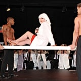 Debbie Harry was carried out by four shirtless men.
