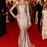 Karolina stuns in Rachel Zoe's gilded confection.
