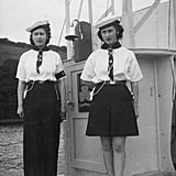 Elizabeth and Margaret looked less than enthused with their Sea Rangers outfits in 1944.