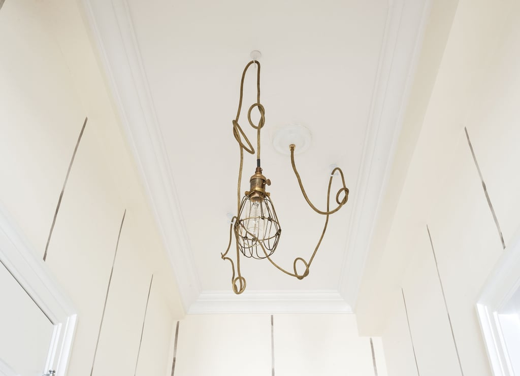 The entryway is proof rental lighting doesn't have to be boring. For an industrial touch, you can find a similar light fixture here.  Photo by  Matthew Williams via LABLstudio