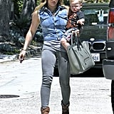 Hilary Duff carried her son, Luca Comrie, to a party in LA.