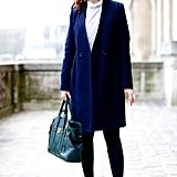 Our fashion news editor Christina Pérez was snapped showing off a minimalist-prep look outside the show.