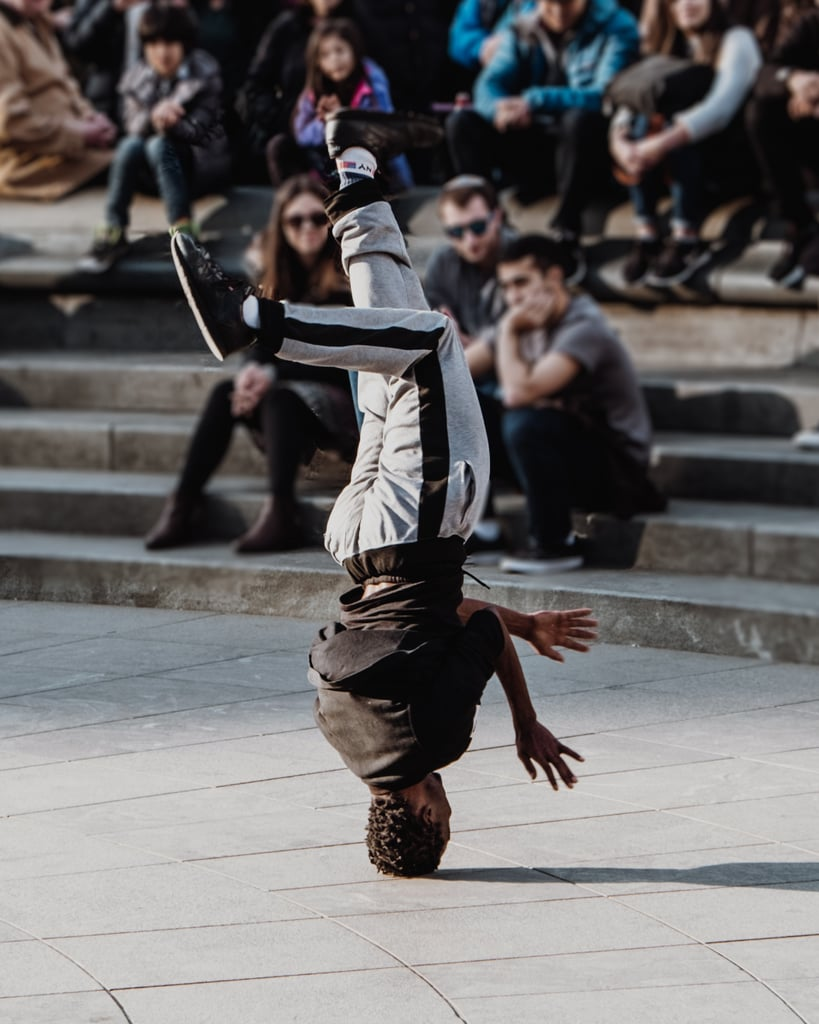 Tell a street performer how amazing he or she is.