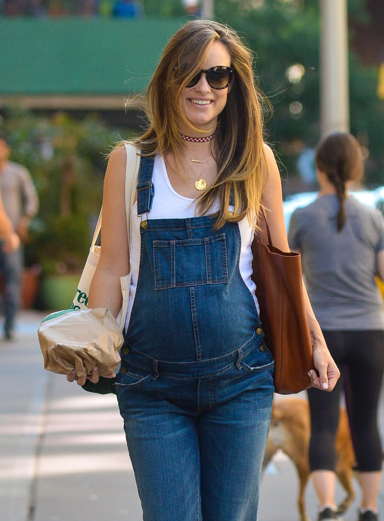 "Olivia Wilde had a pretty busy weekend. On Friday, the actress was spotted picking up lunch in NYC sporting a cute pair of dungarees that barely contained her baby bump. The following day, Olivia hit the stage at the Global Citizen Festival in Central Park, where she covered her growing belly in a printed dress while meeting up with Emma Stone and introducing a performance by Kendrick Lamar. Olivia shared a photo of herself from the event on Instagram, writing: ""Bringing the bump out to 60,000 Global Citizens to introduce my all time 🙌 KENDRICK LAMAR.#lookbothwaysbeforeyoucrossmymind.""  Between bopping around the city and bobbing her head to Kendrick Lamar, Olivia also revealed the sex of her second child with fiancé Jason Sudeikis — while simultaneously taking a jab at presidential nominee Donald Trump. ""As someone who is about to have a daughter, this hits me deep in my core. #NeverTrump,"" Olivia tweeted on Saturday, along with Hillary Clinton's latest campaign ad. The baby girl will join the couple's 2-year-old son Otis.       Related:                                                                                                           Olivia Wilde Gets Fancy While Flaunting Her Growing Baby Bump at an Event"