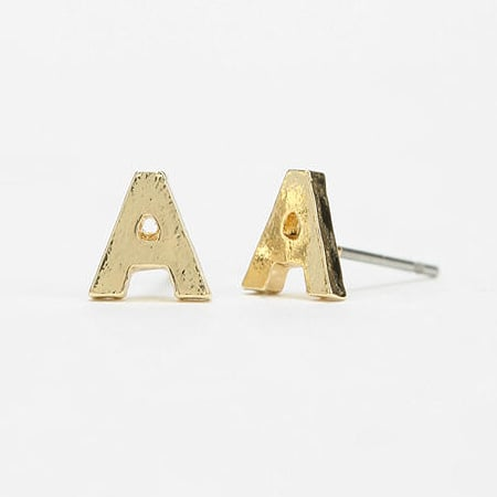 Spell it out with these Urban Outfitters Bold Initial Stud Earrings ($8).