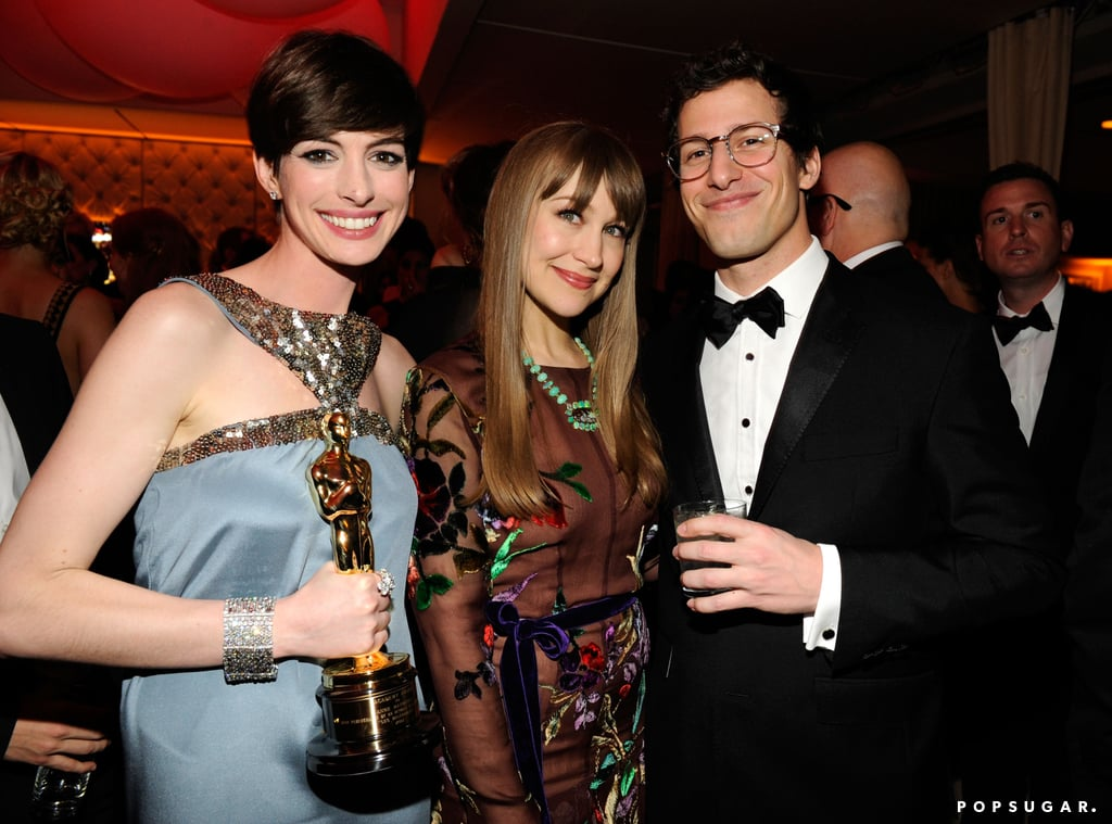 Andy Samberg met up with Anne Hathaway and Joanna Newsom at Vanity Fair's Oscar after-party.