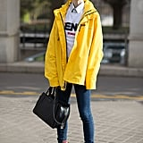 Opt For Red Boots and Style Them With a Bright Yellow Coat