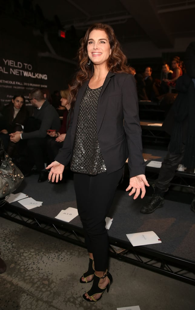Brooke Shields was all smiles in a mirrored grommet tank and sexy cut-out sandals standing front row at Kenneth Cole.