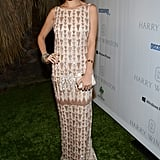 Nicole Richie wore a vintage-inspired Lorena Sarbu paired with a white clutch, art deco jewels, and a wavy updo.