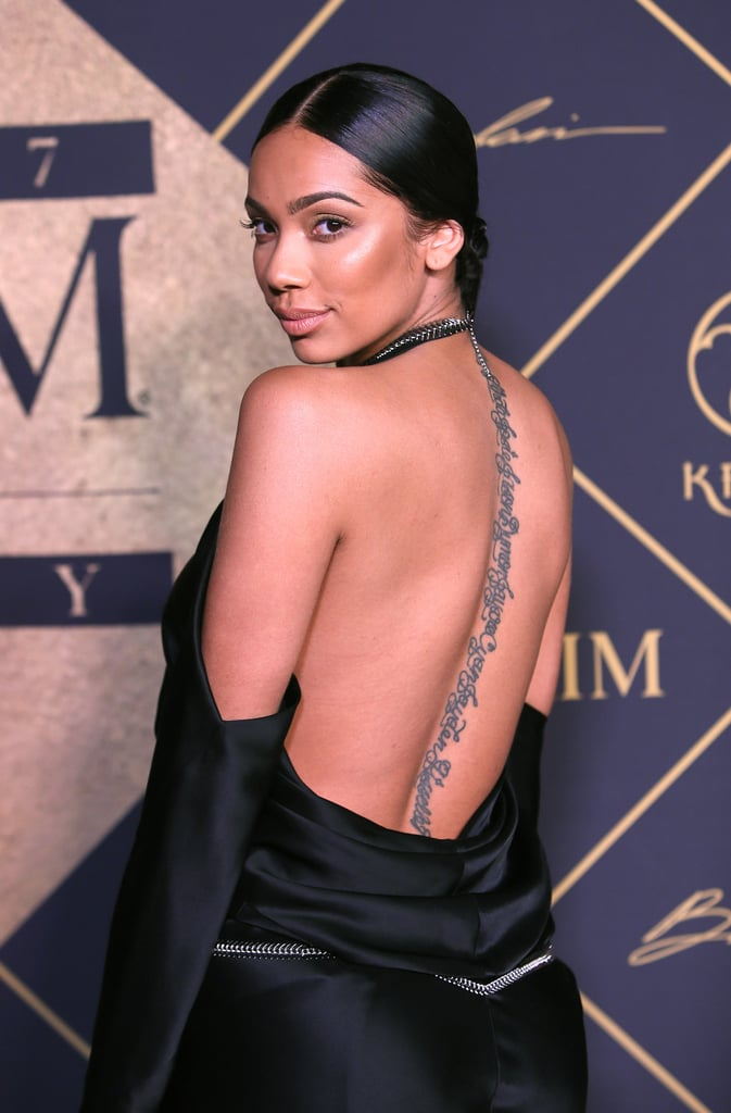 Erica Mena's Writing Spine Tattoo