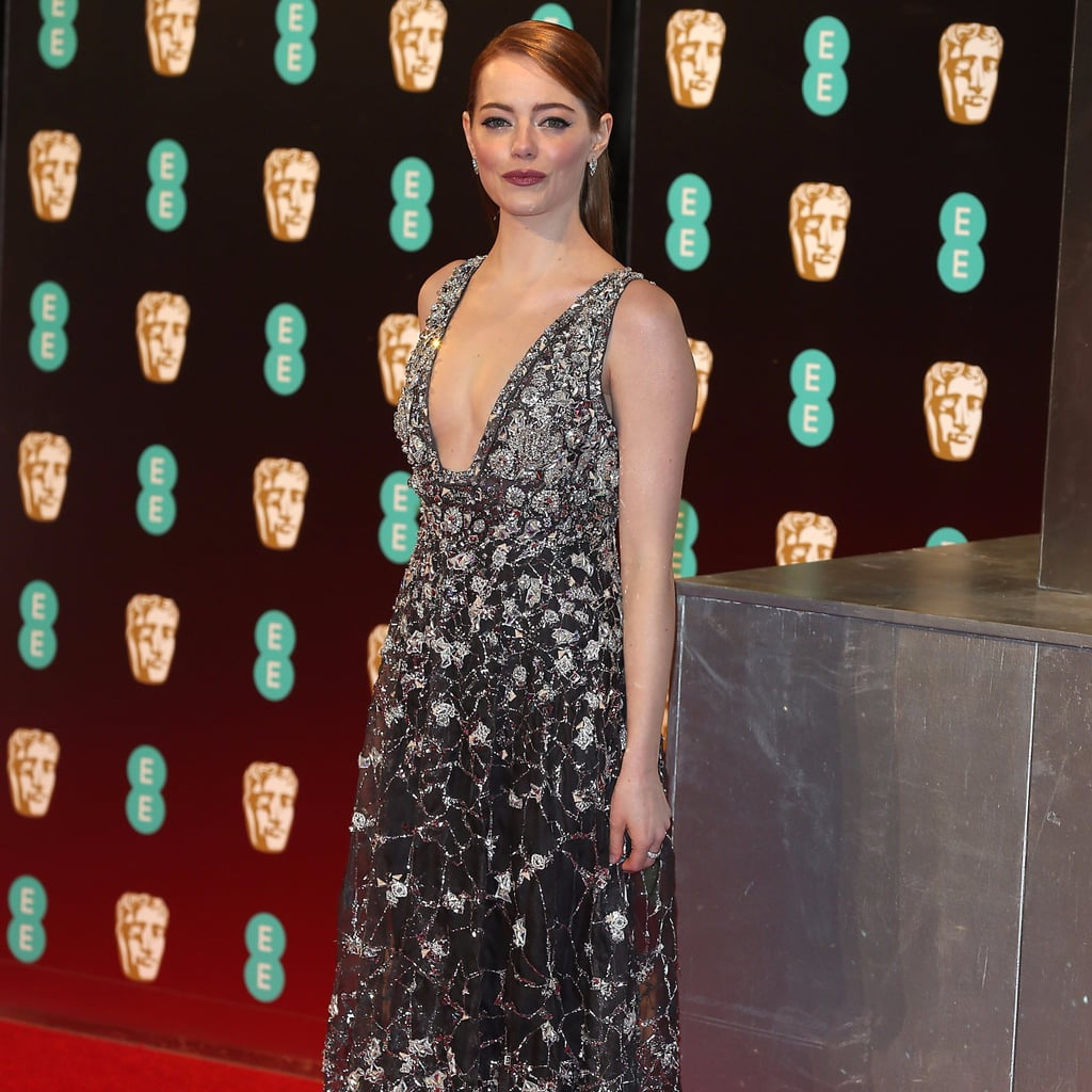 Emma Stone Wearing a Dress Over Trousers at the BAFTA Awards
