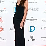 Victoria wearing a spaghetti-strap column gown to The Global Gift Gala in 2015.