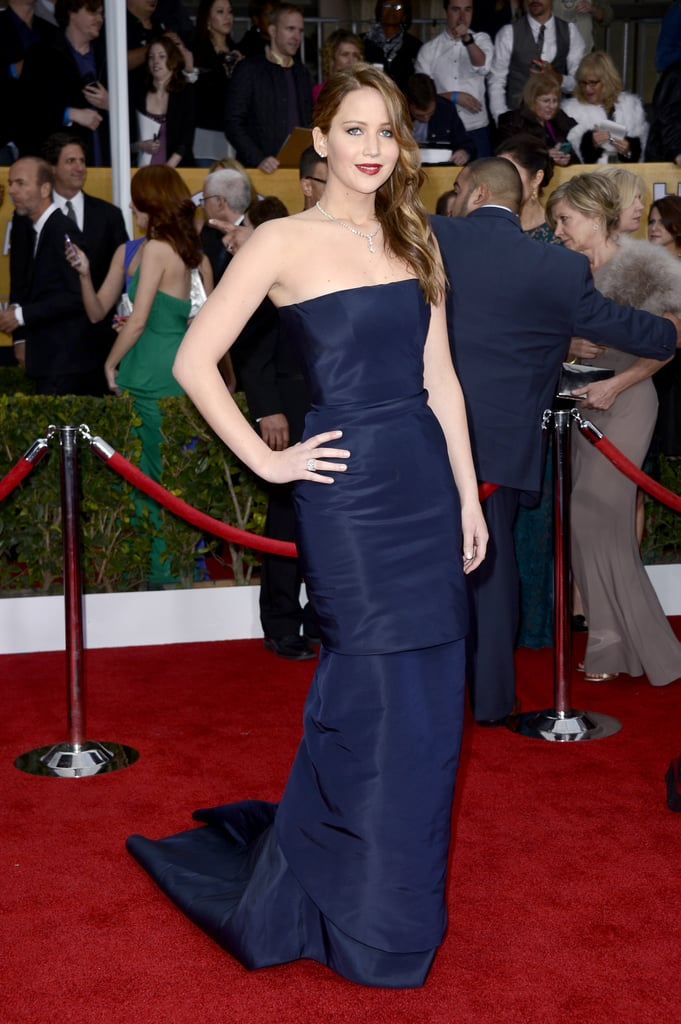 Jennifer Lawrence was a vision in a navy blue Dior Haute Couture gown with Jimmy Choo sandals and a glistening Chopard necklace.